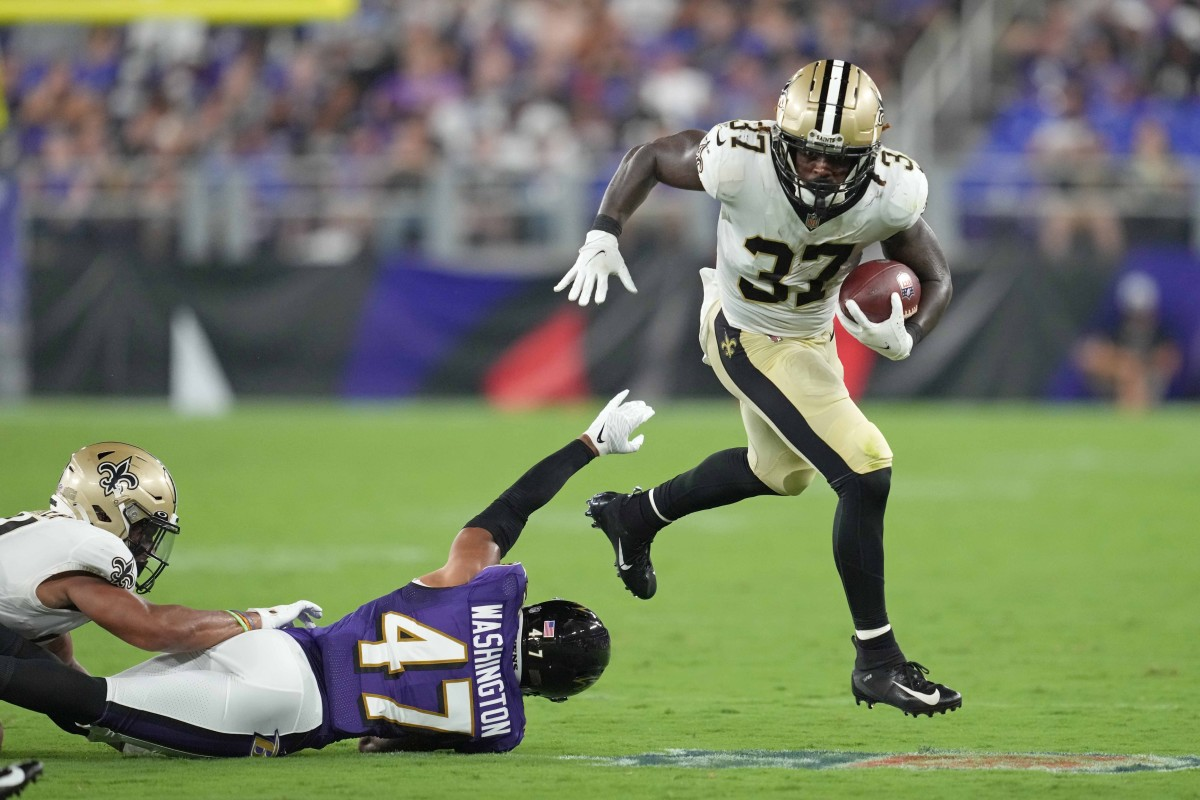 New Orleans Saints running back Tony Jones Jr. (37) runs for a gain defended by Baltimore safety Ar Darius Washington (47). Mandatory Credit: Mitch Stringer-USA TODAY