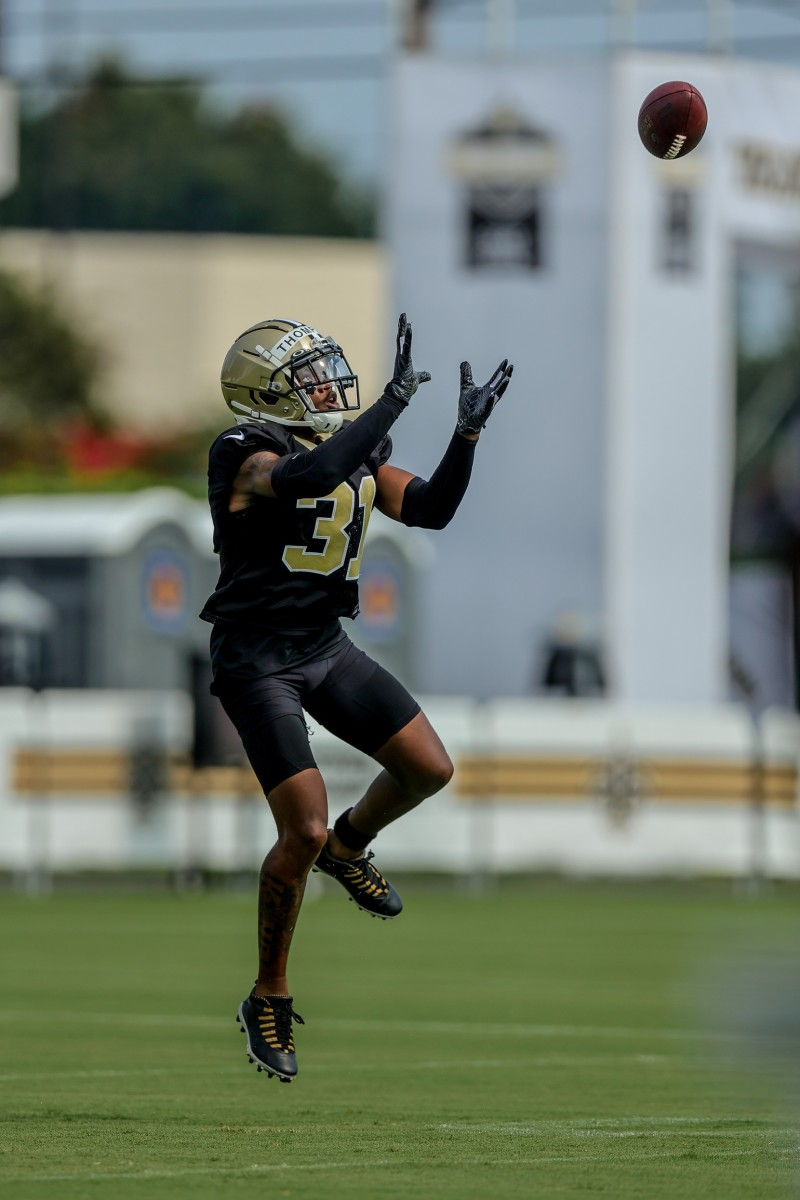 New Orleans Saints cornerback Bryce Thompson (31) performs defensive back drills during a training camp session. Mandatory Credit: Stephen Lew-USA TODAY Sports