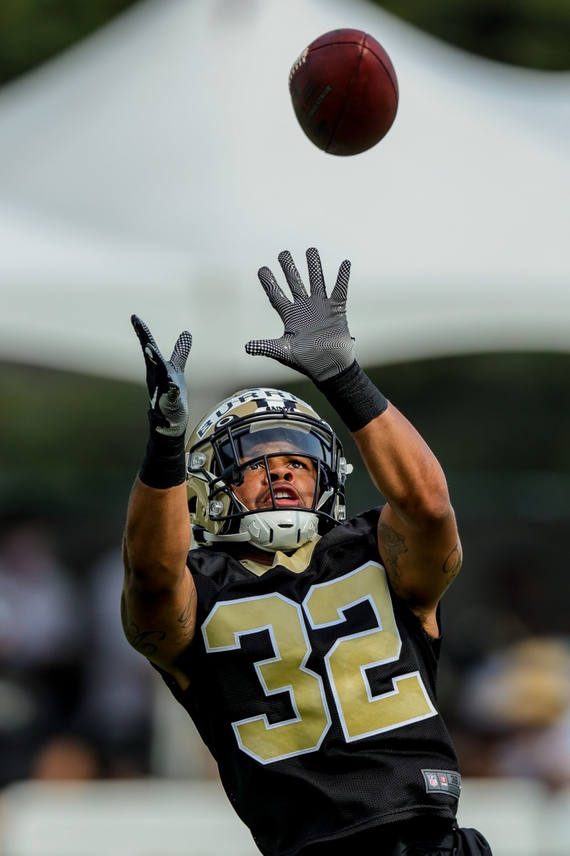 New Orleans Saints safety Eric Burrell (32) performs drills during a training camp session. Mandatory Credit: Stephen Lew-USA TODAY Sports