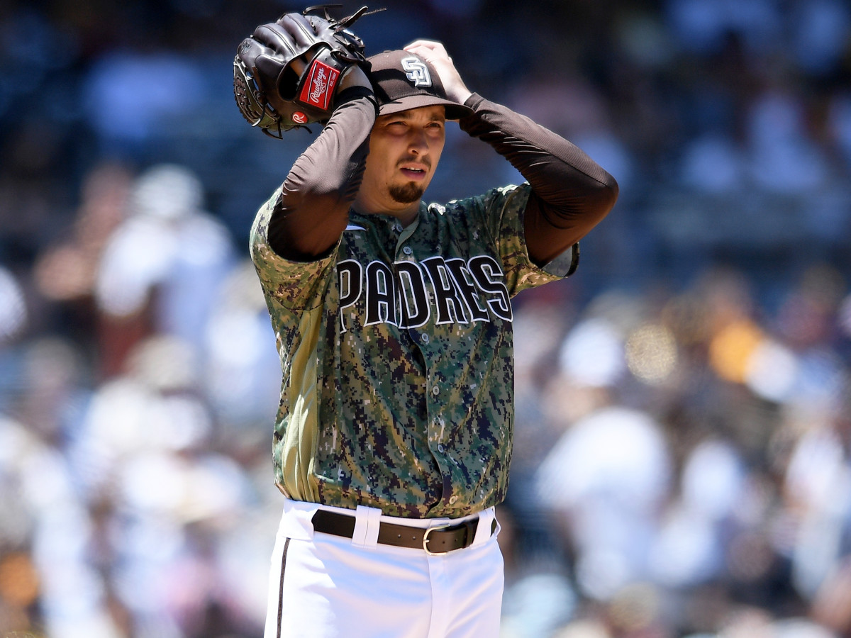 Aug 8, 2021; San Diego, California, USA; San Diego Padres starting pitcher Blake Snell (4) adjusts his cap after issuing a walk to an Arizona Diamondbacks batter during the fourth inning at Petco Park.