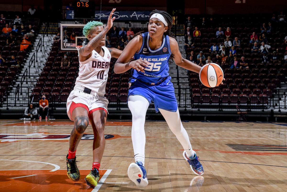 Jonquel Jones dribbles the basketball against the Atlanta Dream