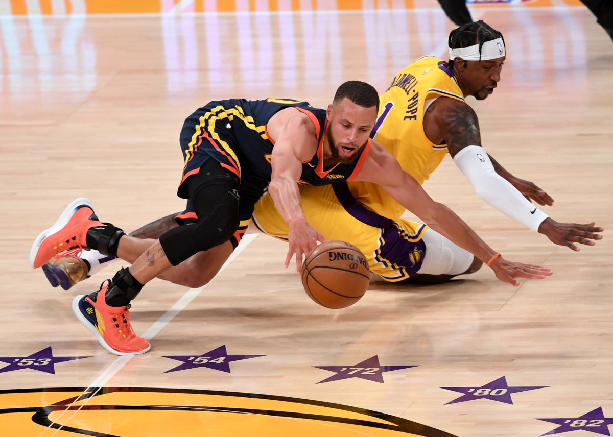 May 19, 2021; Los Angeles, California, USA; Los Angeles Lakers guard Kentavious Caldwell-Pope (1) and Golden State Warriors guard Stephen Curry (30) scramble for a loose ball in the fourth quarter of the game at Staples Center. Mandatory Credit: Jayne Kamin-Oncea-USA TODAY Sports