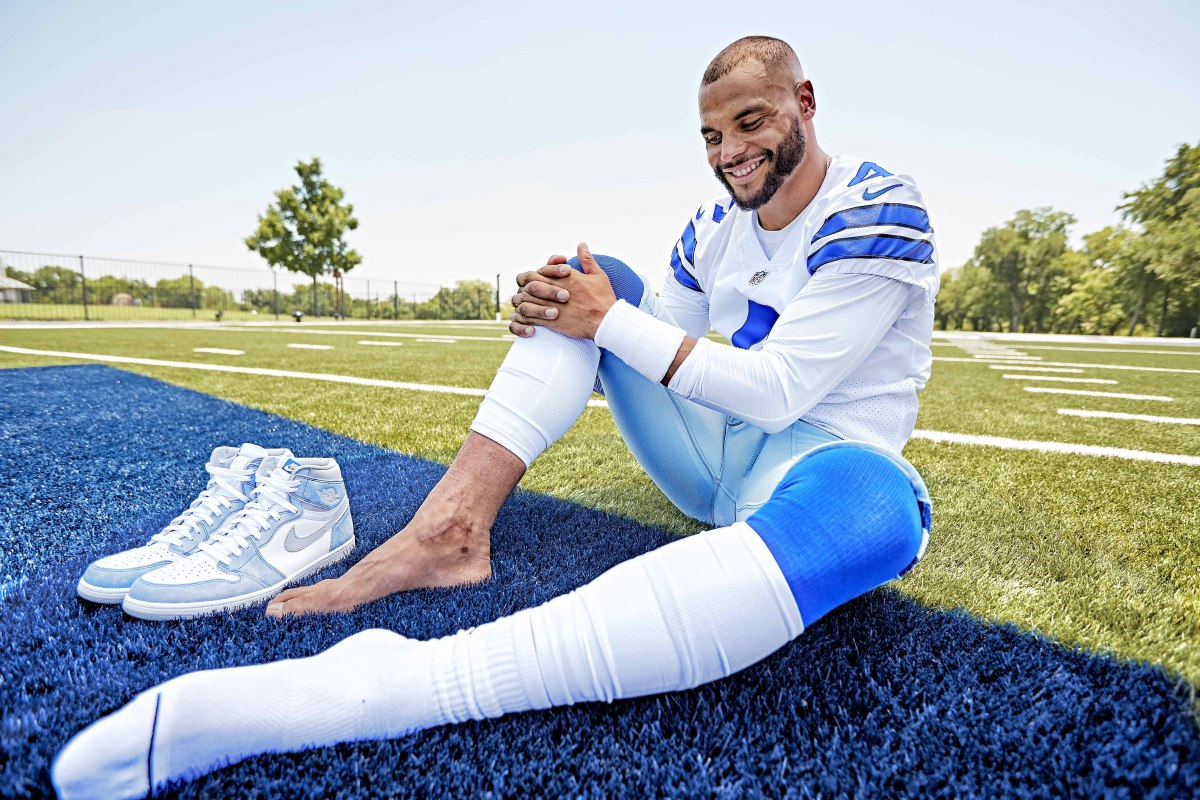 Dak Prescott poses for a photo, showing the scar on his right ankle