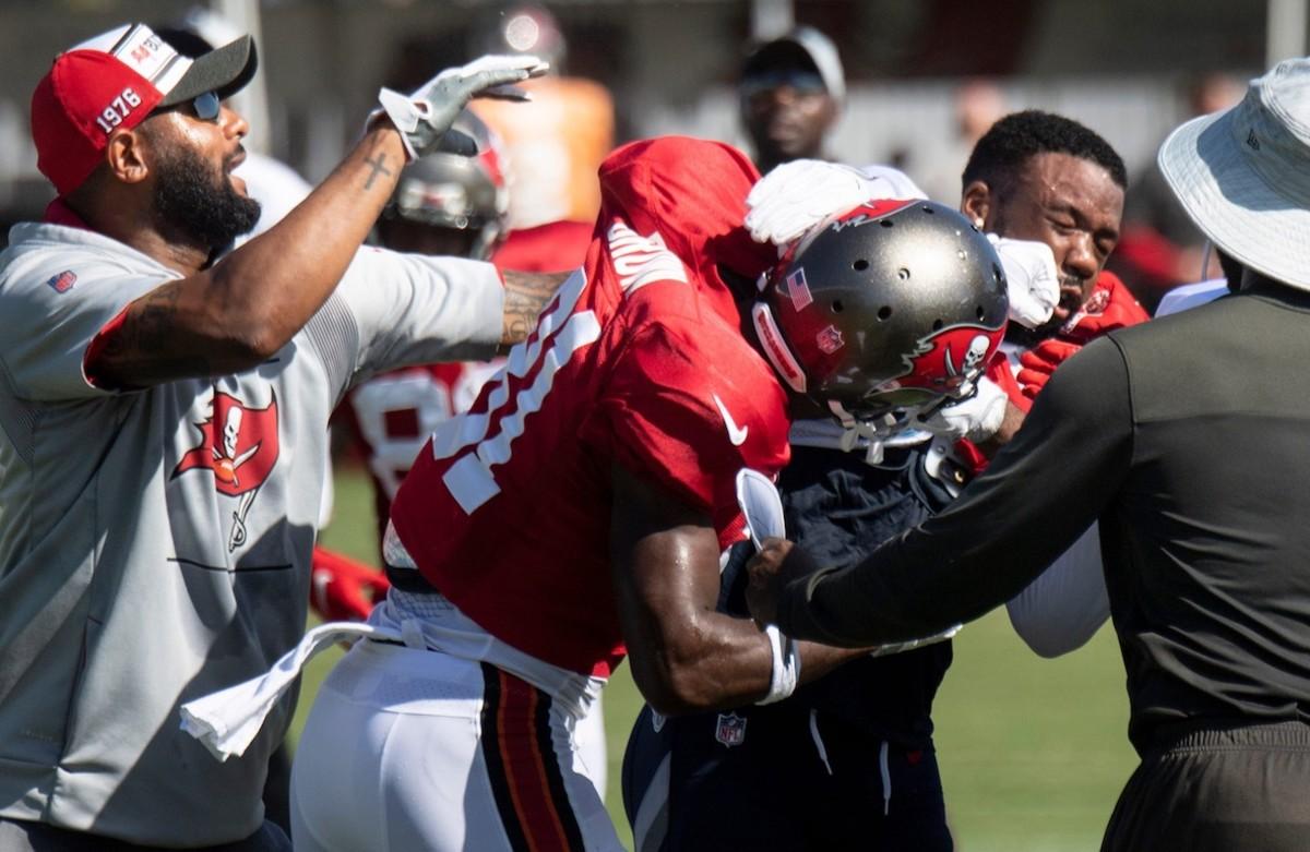 Buccaneers wide receiver Antonio Brown punches Titans cornerback Chris Jackson.