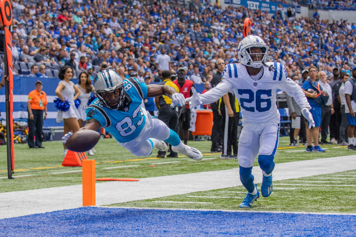 Aug 15, 2021; Indianapolis, Indiana, USA; Carolina Panthers wide receiver David Moore (83) dives to catch the ball while Indianapolis Colts cornerback Rock Ya-Sin (26) defends the first quarter at Lucas Oil Stadium. Mandatory Credit: Trevor Ruszkowski-USA TODAY Sports
