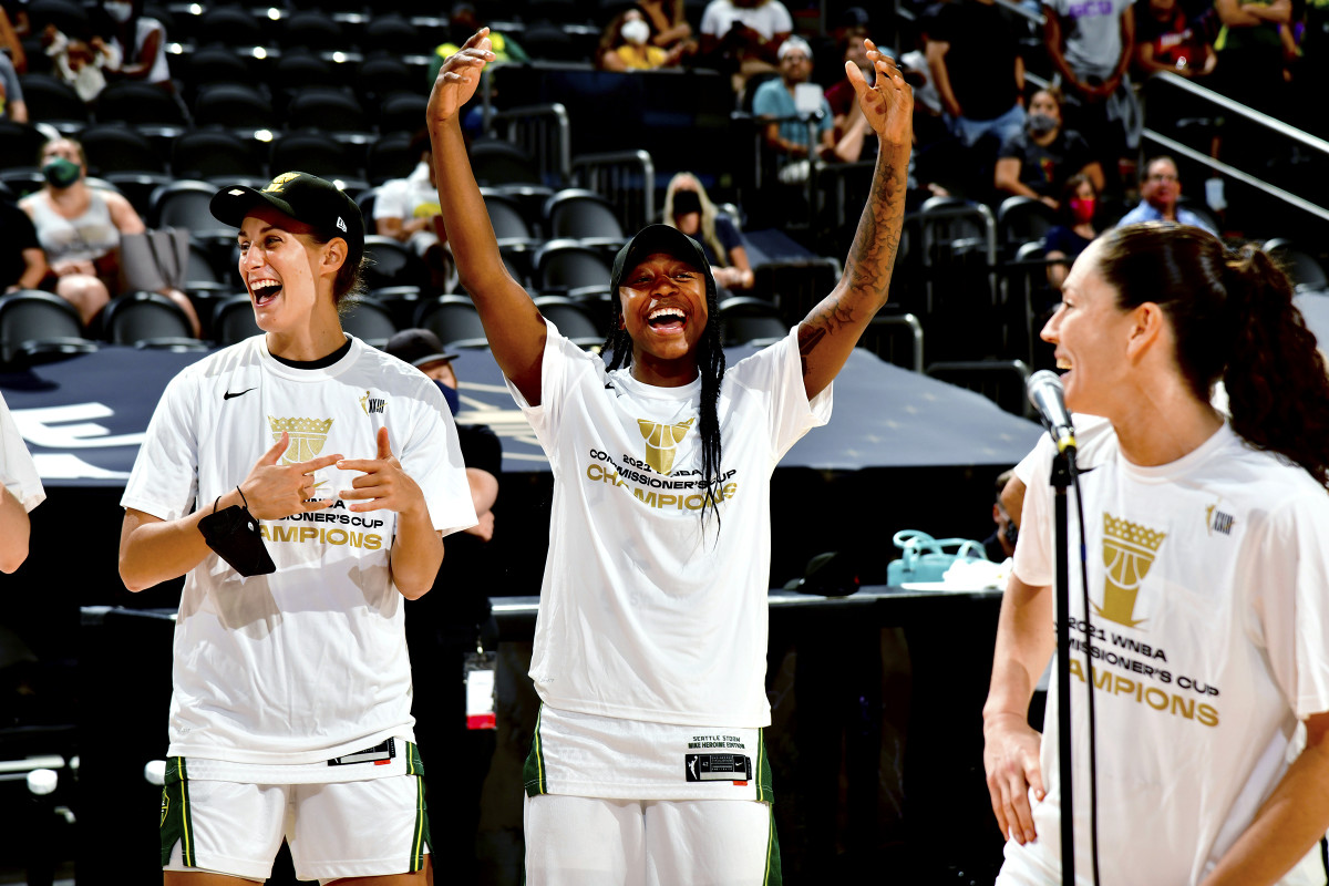 Stephanie Talbot, Jewell Loyd and Sue Bird celebrate winning the Commissioner's Cup