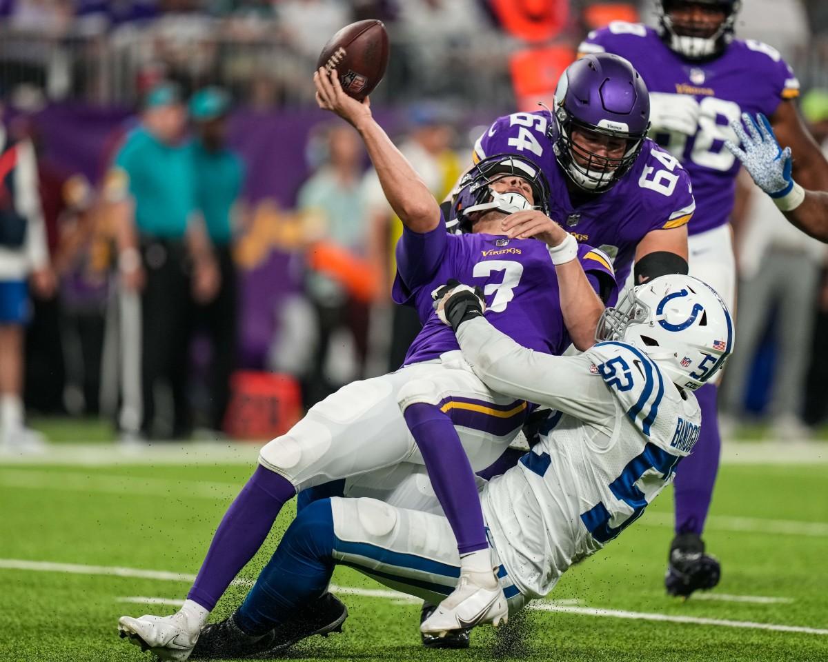 Aug 21, 2021; Minneapolis, Minnesota, USA; Minnesota Vikings quarterback Jake Browning (3) is sacked by Indianapolis Colts defensive end Ben Banogu (52) during the second quarter at U.S. Bank Stadium.