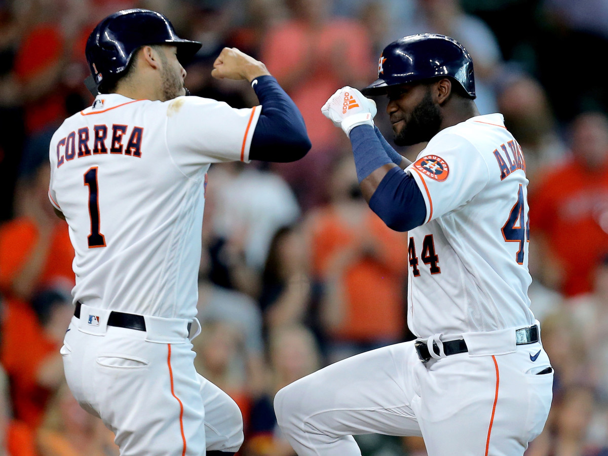 Aug 21, 2021; Houston, Texas, USA; Houston Astros designated hitter Yordan Alvarez (44, right) is congratulated by Houston Astros shortstop Carlos Correa (1, left) after hitting a three-run home run against the Seattle Mariners during the third inning at Minute Maid Park.