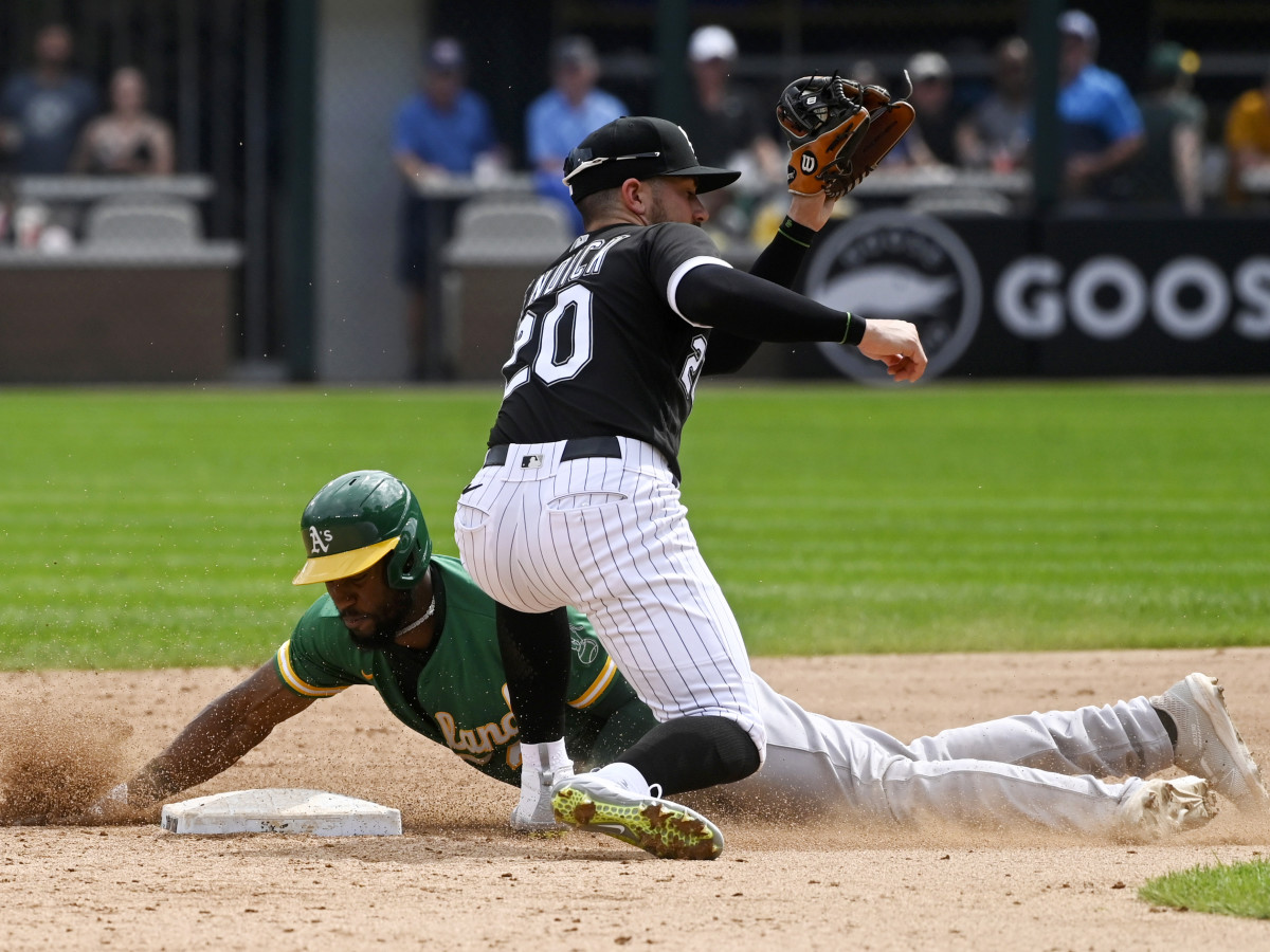 Aug 19, 2021; Chicago, Illinois, USA; Chicago White Sox second baseman Danny Mendick (20) misses the tag on Oakland Athletics center fielder Starling Marte (2) during the fifth inning at Guaranteed Rate Field.