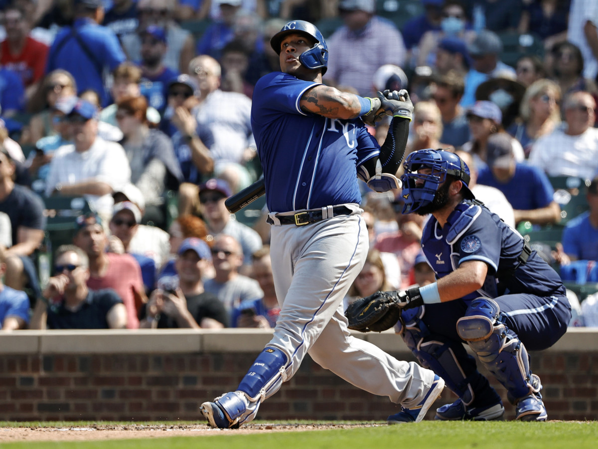 Aug 20, 2021; Chicago, Illinois, USA; Kansas City Royals catcher Salvador Perez (13) hits a solo home run against the Chicago Cubs during the sixth inning at Wrigley Field.