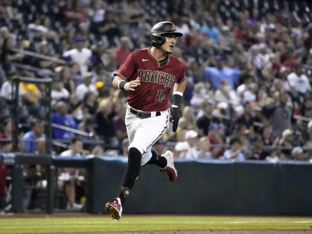 Aug 15, 2021; Phoenix, Arizona, USA; Arizona Diamondbacks third baseman Josh Rojas (10) scores a run against the San Diego Padres in the third inning at Chase Field.