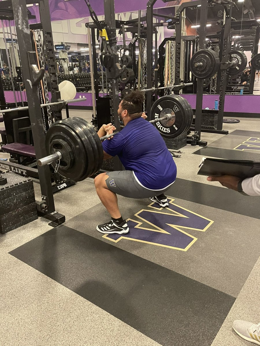 Nate Kalepo builds strength in the weight room.