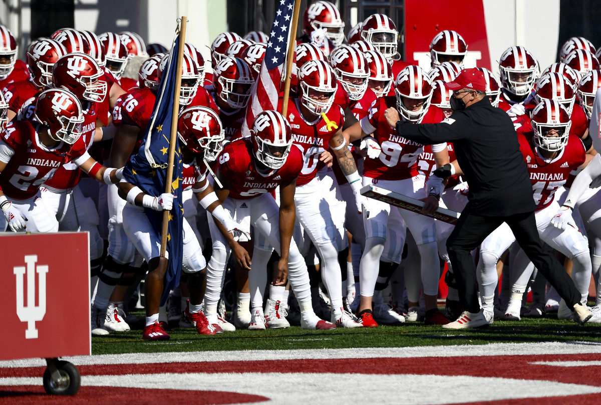 Indiana's Tom Allen leads his team onto the field