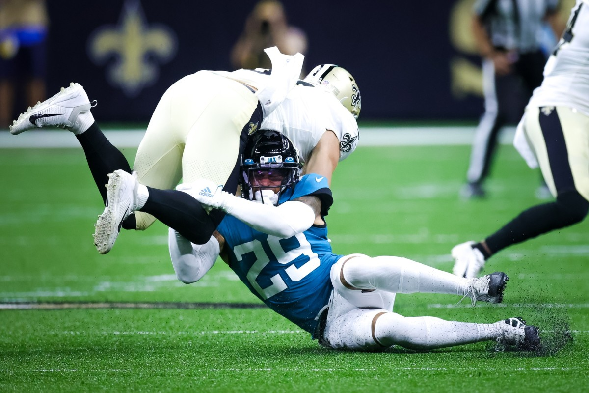 New Orleans Saints tight end Nick Vannett (81) is tackled by Jacksonville safety Josh Jones (29). Mandatory Credit: Stephen Lew-USA TODAY Sports