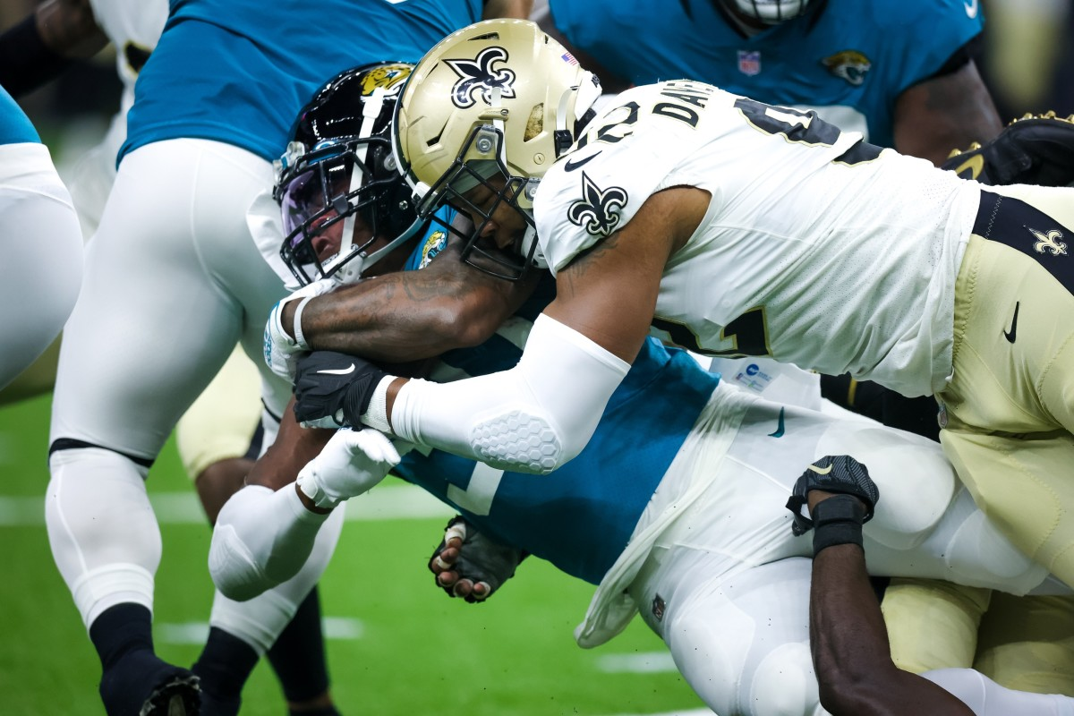 New Orleans Saints defensive end Marcus Davenport (92) tackles Jaguars running back Nathan Cottrell (31). Mandatory Credit: Stephen Lew-USA TODAY Sports