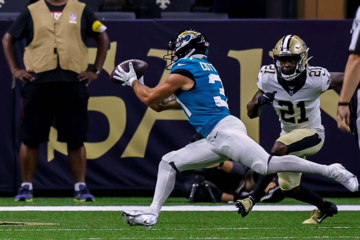 Jacksonville running back Nathan Cottrell (31) converts a two point conversion against New Orleans Saints cornerback Natrell Jamerson (21). Mandatory Credit: Stephen Lew-USA TODAY Sports