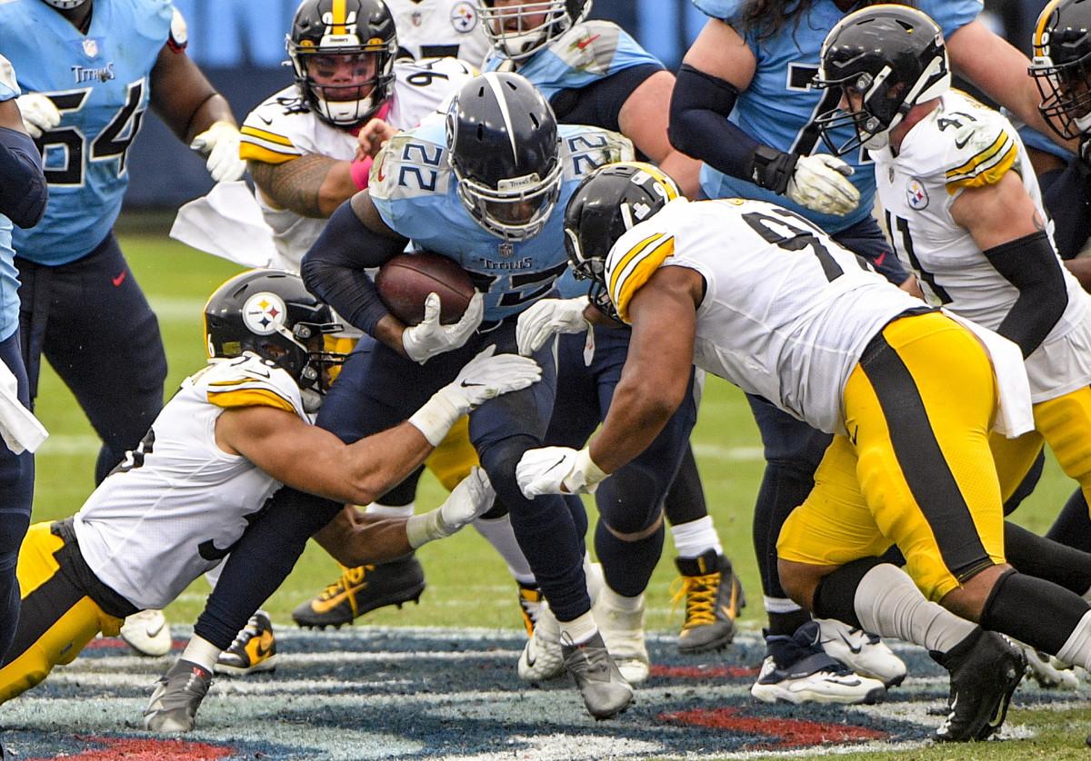 Derrick Henry runs through a crowd against the Steelers