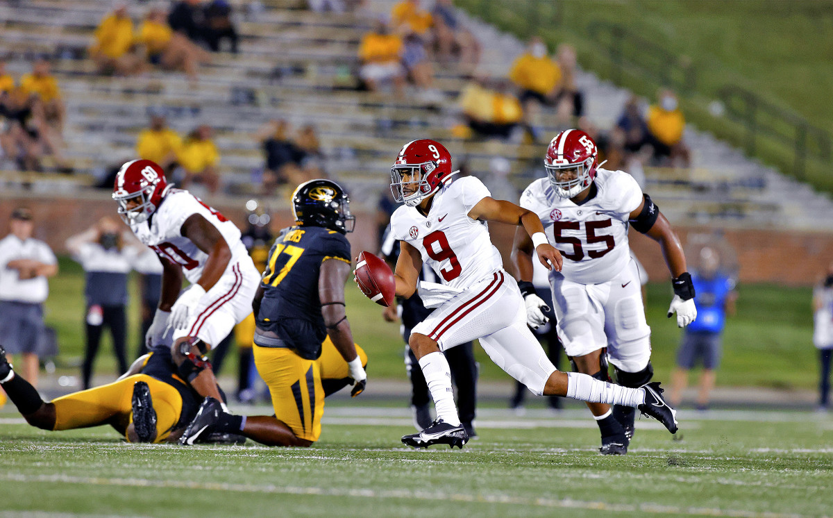 Alabama's Bryce Young runs with the ball