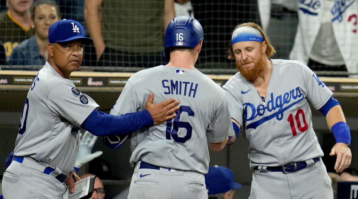 Los Angeles Dodgers catcher Will Smith (16) is congratulated by manager Dave Roberts (left) and third baseman Justin Turner (10) after his home run in the seventh inning at Petco Park.