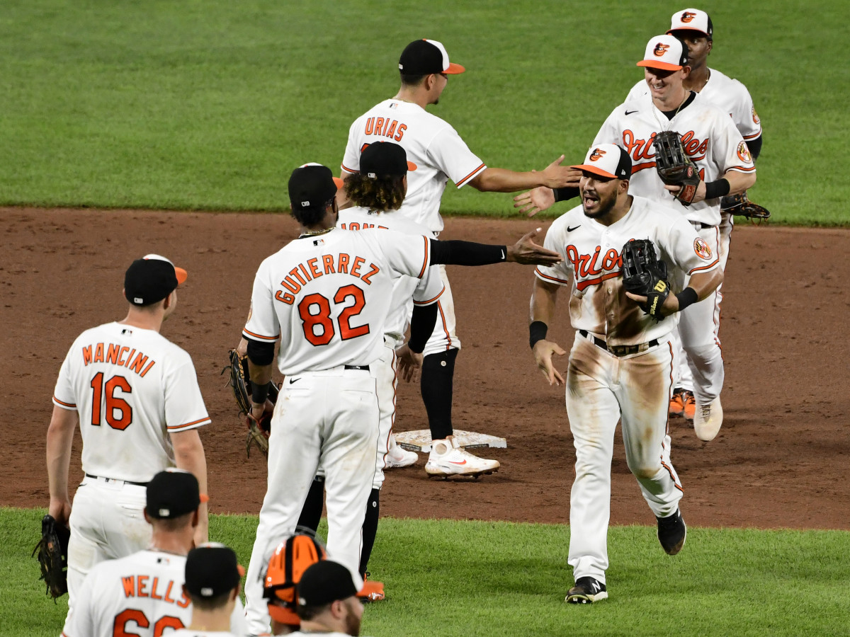 Aug 25, 2021; Baltimore, Maryland, USA; Baltimore Orioles right fielder Anthony Santander (25) celebrates with teammates after beating against the Los Angeles Angels ending their 19 game loosing streak. at Oriole Park at Camden Yards.