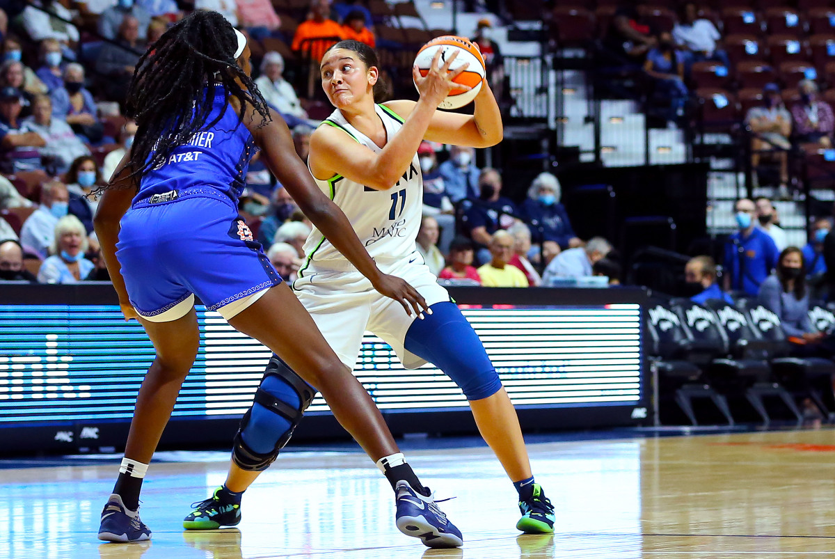 Natalie Achonwa holds a basketball
