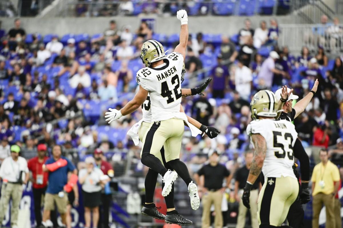 New Orleans Saints linebacker Kaden Elliss (55) celebrates with Chase Hansen (42) against the Baltimore Ravens. Mandatory Credit: Tommy Gilligan-USA TODAY Sports