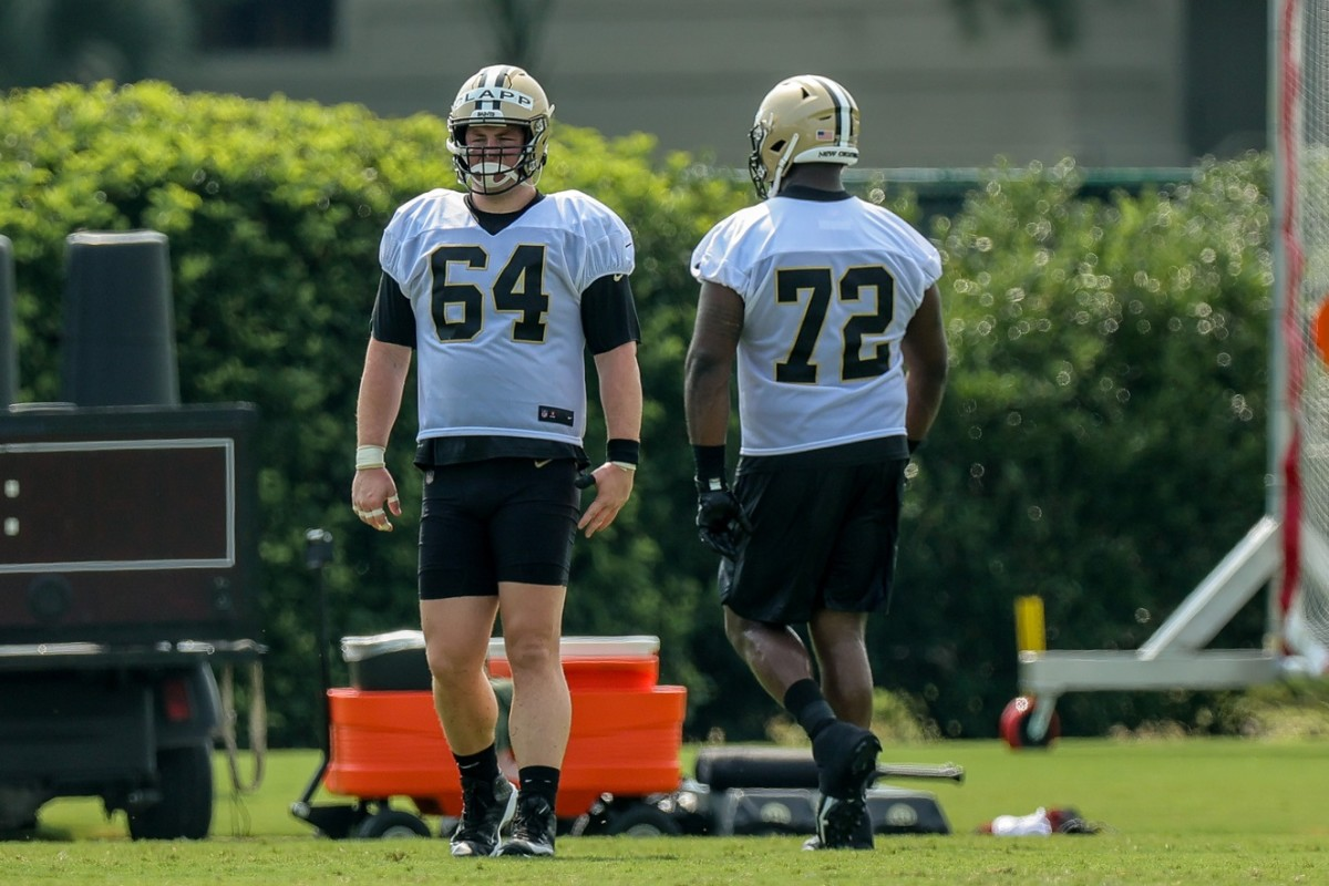 New Orleans Saints center Will Clapp (64) and tackle Terron Armstead (72) look on during a training camp session. Mandatory Credit: Stephen Lew-USA TODAY Sports