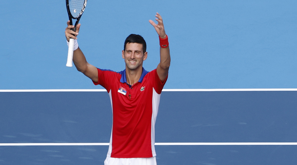 Novak Djokovic holding up a tennis racket