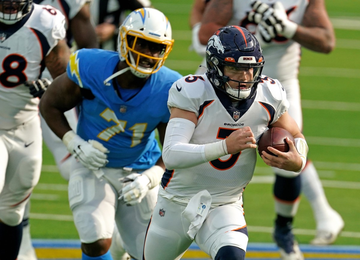 Denver Broncos quarterback Drew Lock (3) runs with the ball as Chargers Damion Square (71) pursues. Mandatory Credit: Kirby Lee-USA TODAY Sports