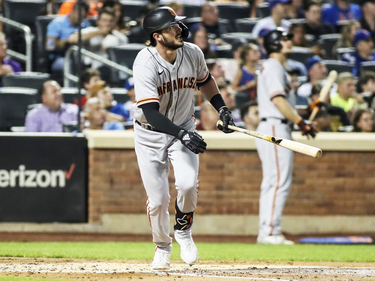 Aug 25, 2021; New York City, New York, USA;  San Francisco Giants third baseman Kris Bryant (23) hits a solo home run in the fourth inning against the New York Mets at Citi Field.