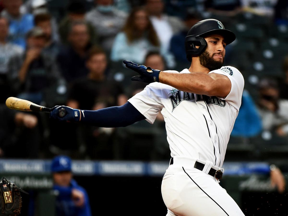 Aug 26, 2021; Seattle, Washington, USA; Seattle Mariners second baseman Abraham Toro hits a base hit against the Kansas City Royals at T-Mobile Park.