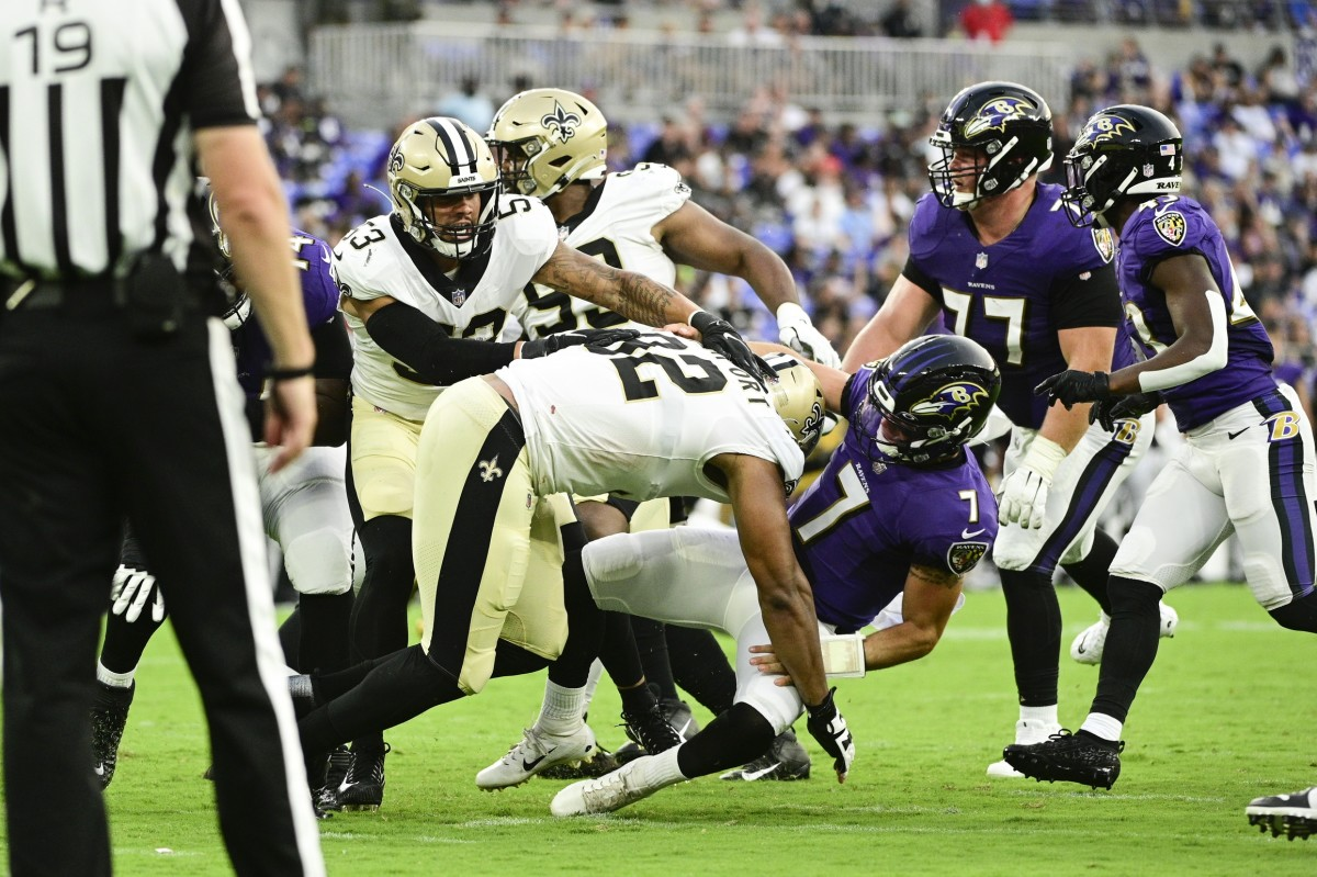 New Orleans Saints defensive end Marcus Davenport (92) takes down Baltimore Ravens quarterback Trace McSorley (7). Mandatory Credit: Tommy Gilligan-USA TODAY