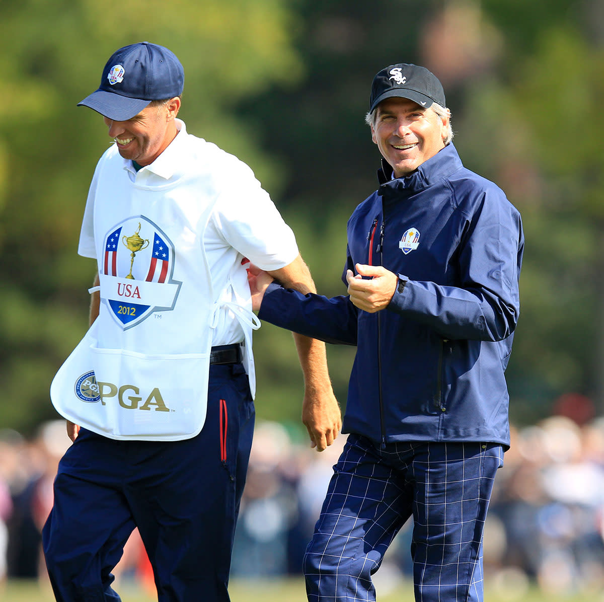 """Fred Couples (right) and Jim """"Bones"""" Mackay at the 2012 Ryder Cup."""