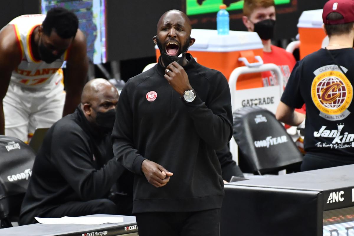 Atlanta Hawks head coach Lloyd Pierce yells to his team during the third quarter against the Cleveland Cavaliers.