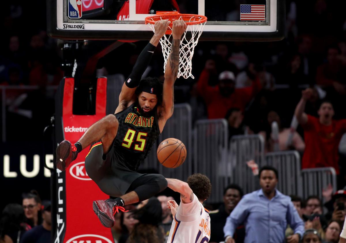 Atlanta Hawks guard DeAndre' Bembry makes a reverse dunk in the fourth quarter against the Phoenix Suns.
