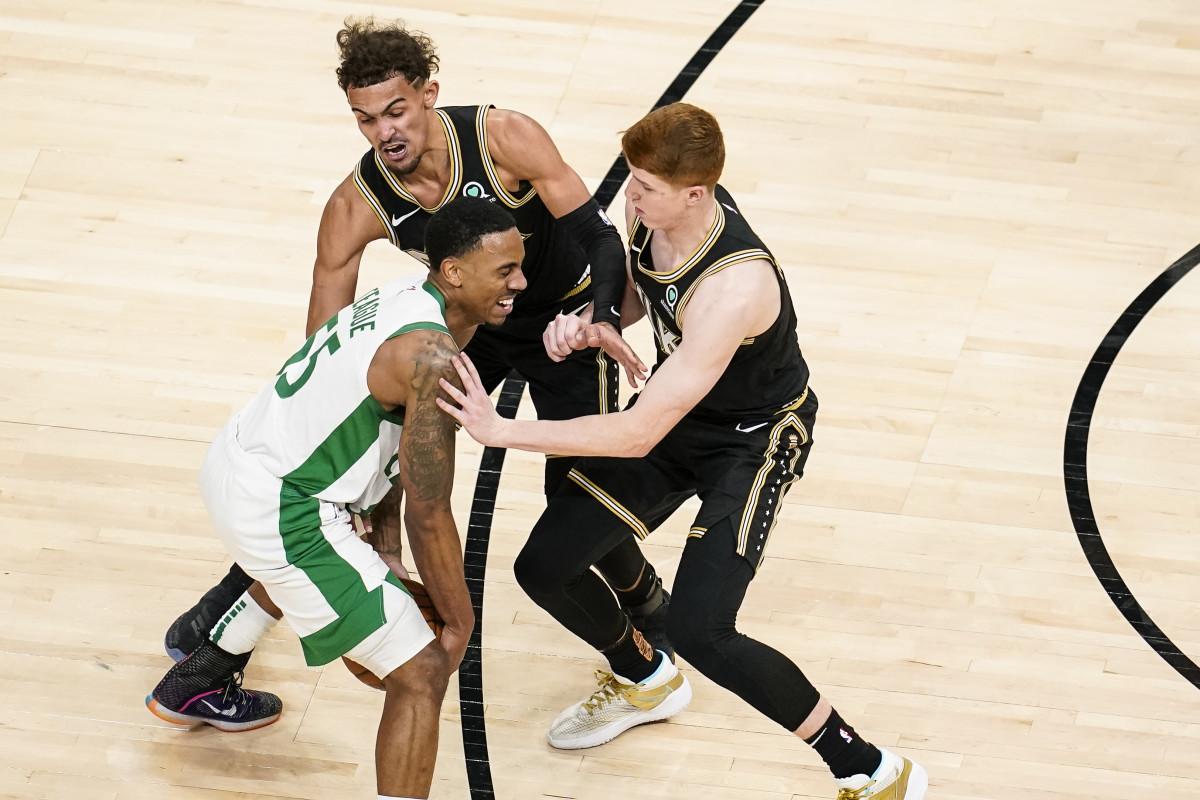 Boston Celtics guard Jeff Teague (55) gets hit in the face by Atlanta Hawks guard Kevin Huerter (3)