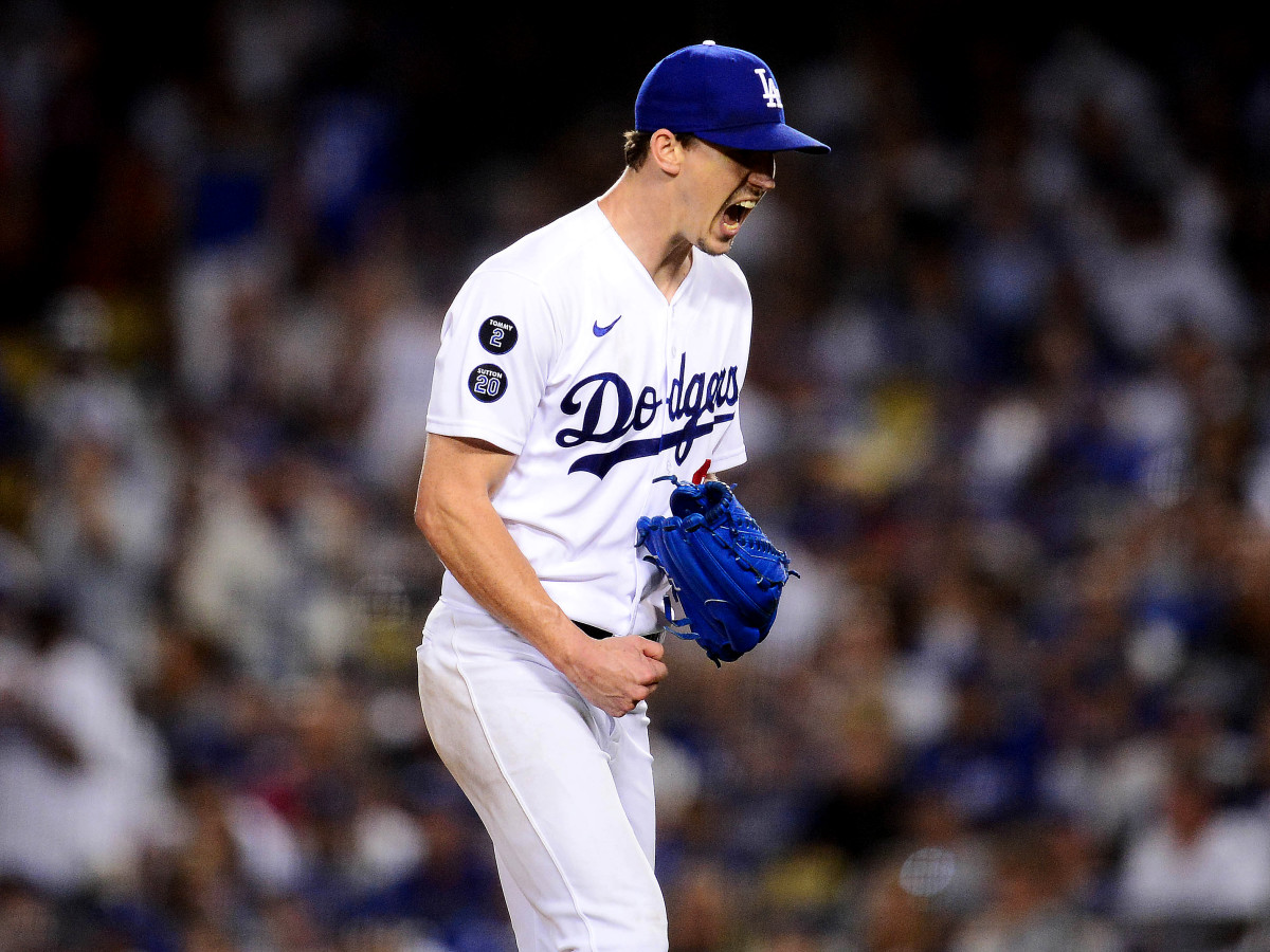 Aug 3, 2021; Los Angeles, California, USA; Los Angeles Dodgers starting pitcher Walker Buehler (21) reacts following the top of the sixth inning against the Houston Astros at Dodger Stadium.