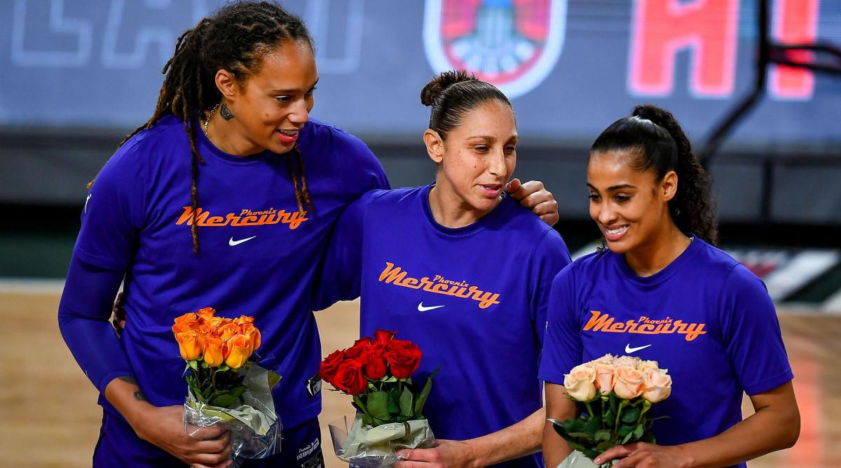 Brittney Griner, Diana Taurasi, and Skylar Diggins-Smith holding flowers