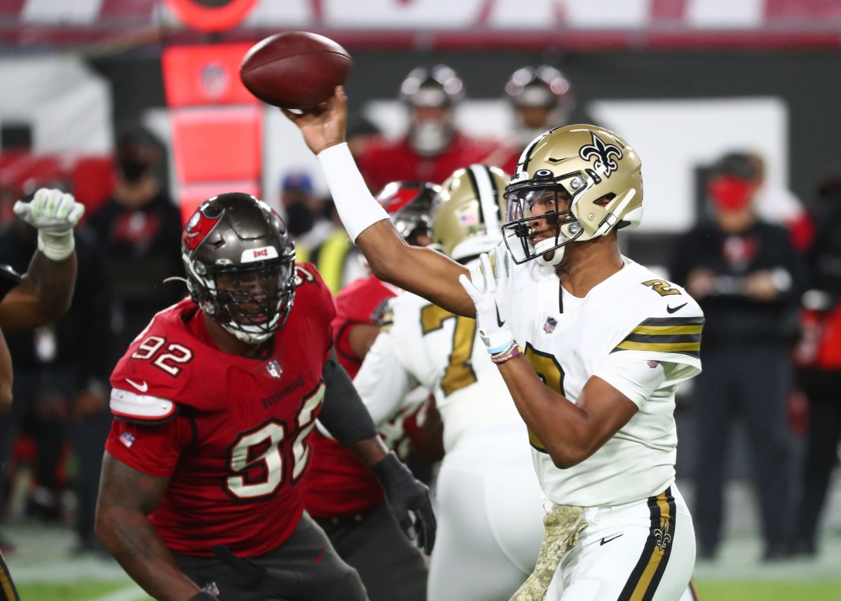 New Orleans Saints quarterback Jameis Winston (2) throws the ball as Tampa Bay defensive end William Gholston (92) rushes. Mandatory Credit: Kim Klement-USA TODAY