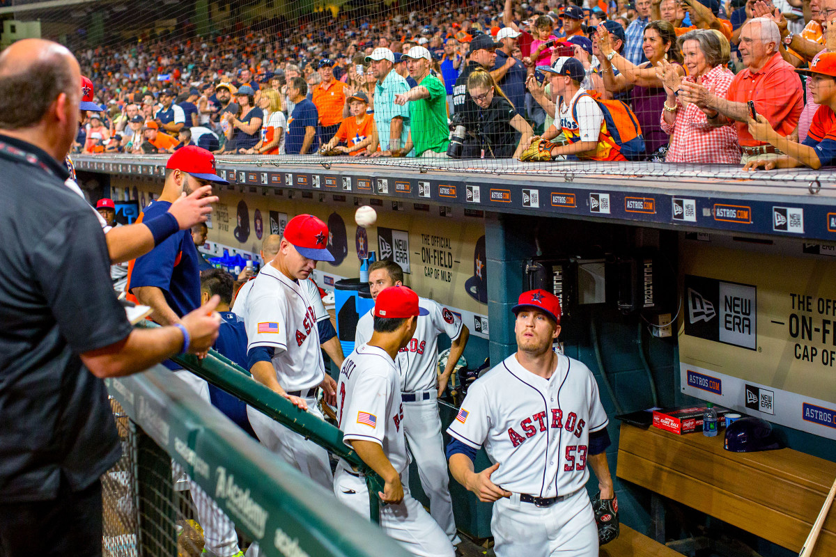 After he got the save in a July 2017 win over the Yankees, Astros reliever Ken Giles (53) knew what to do: unite the game ball with its authenticator.