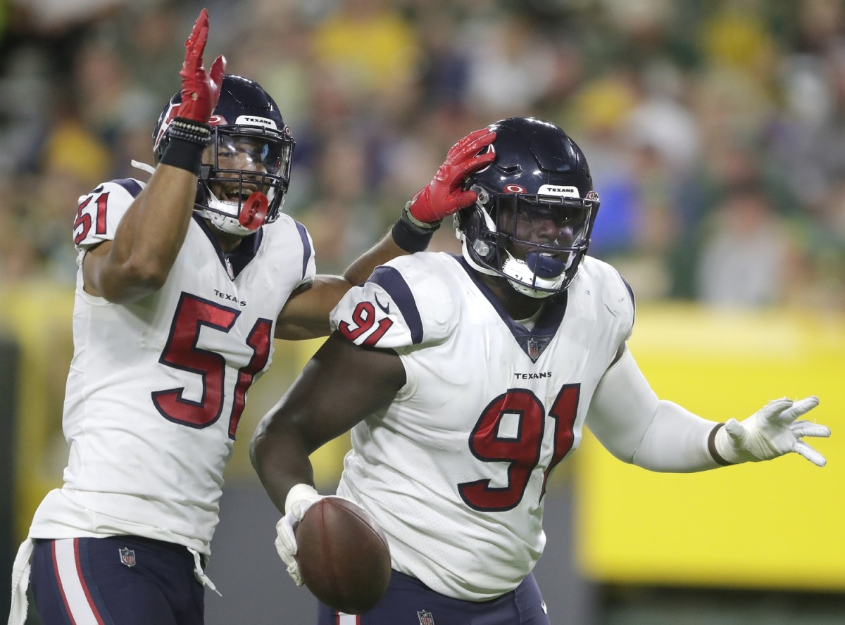 Texans defensive tackle Jaleel Johnson (91) celebrates a fumble recovery against Green Bay during a preseason game. Mandatory Credit: Wm Glasheen/USA TODAY NETWORK-Wisconsin via USA TODAY NETWORK