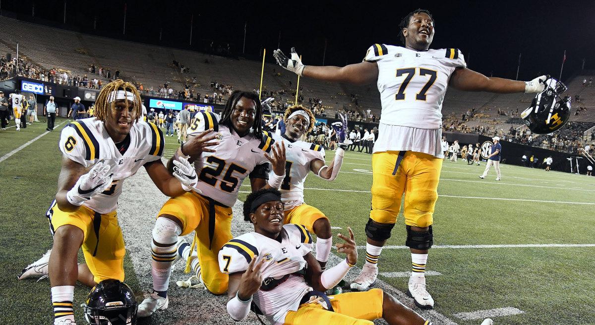 ETSU football celebrates its win over Vanderbilt
