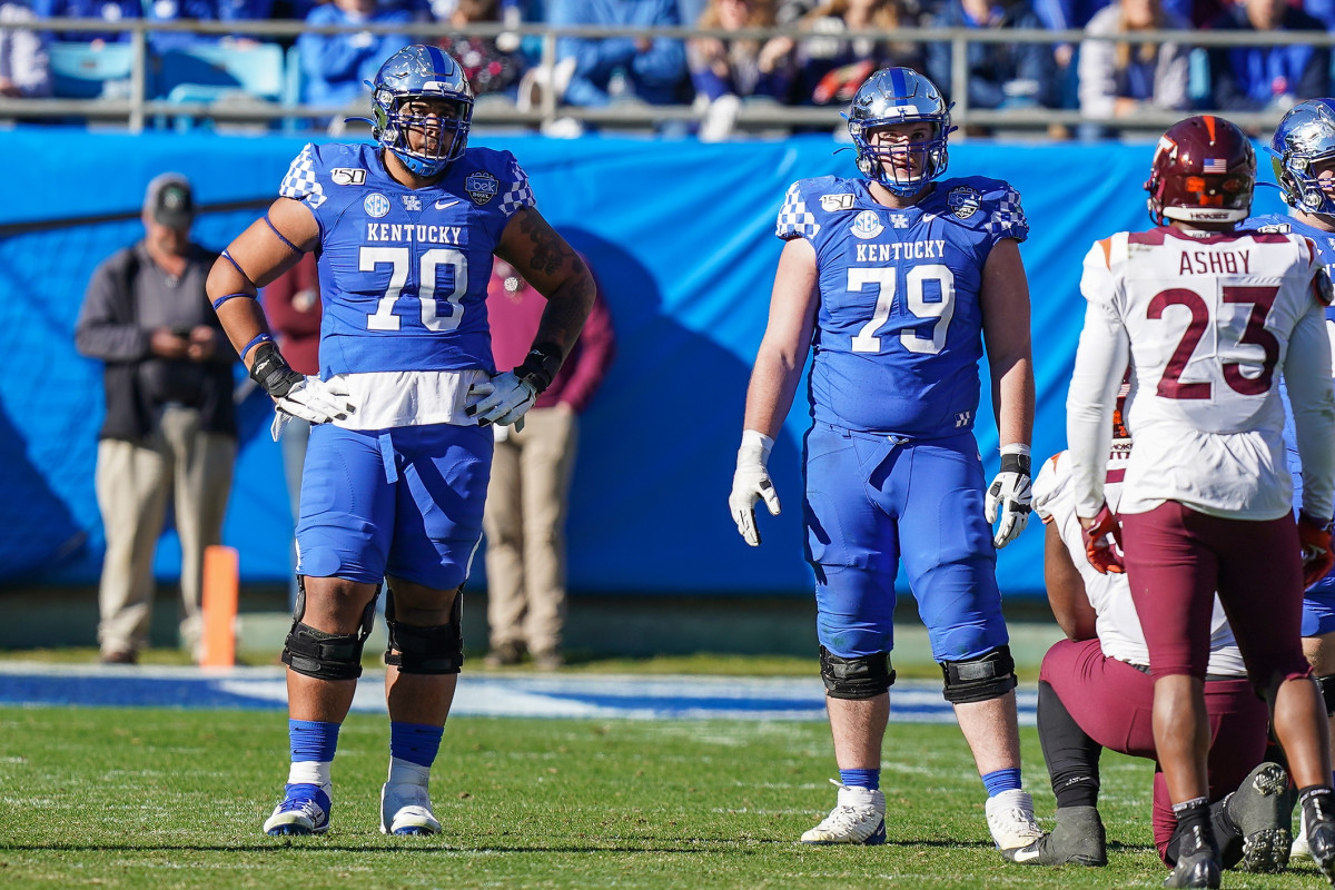 Darian Kinnard (left) is a massive offensive line prospect with excellent power.