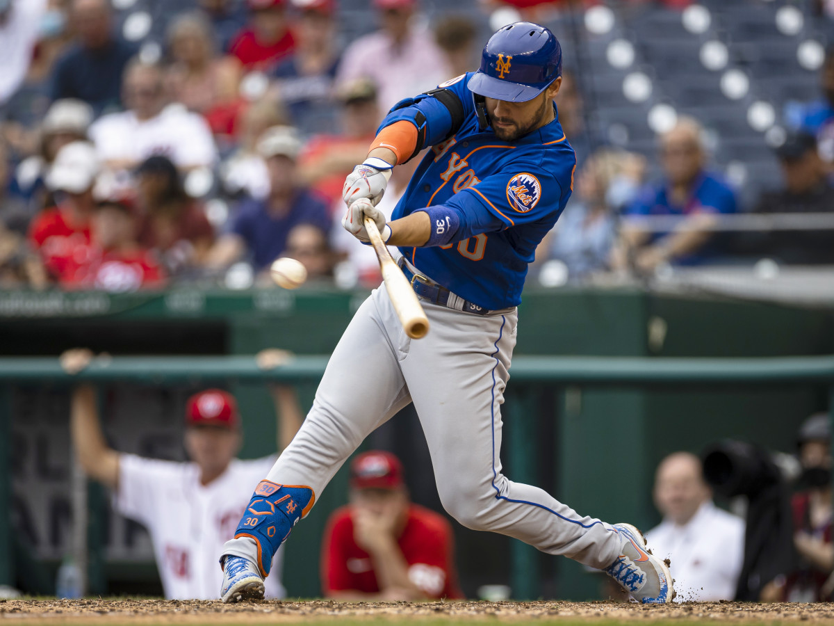 Sep 5, 2021; Washington, District of Columbia, USA; New York Mets right fielder Michael Conforto (30) hits an RBI double against the Washington Nationals during the ninth inning at Nationals Park.