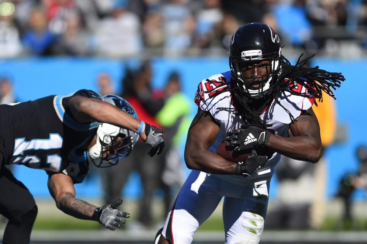 Atlanta Falcons cornerback Desmond Trufant (21) intercepts a pass intended for Carolina receiver D.J. Moore (12). Mandatory Credit: Bob Donnan-USA TODAY Sports