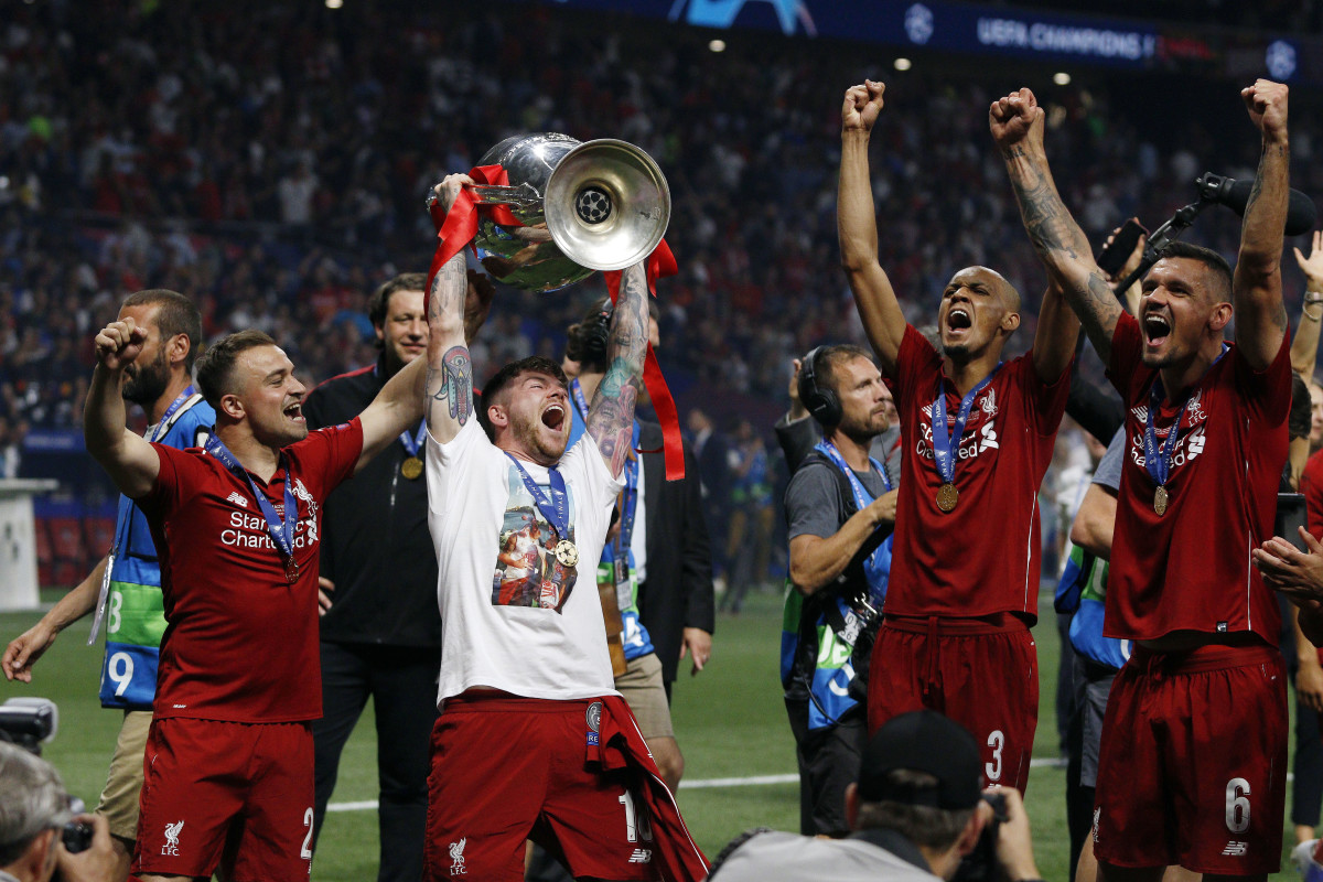 Liverpool's FC Alberto Moreno poses with the trophy as he celebrate the victory after the Final Round of the UEFA Champions League match between Tottenham Hotspur FC and Liverpool FC at Wanda Metropolitano Stadium in Madrid. Final Score: Tottenham Hotspur FC 0 - 2 Liverpool FC
