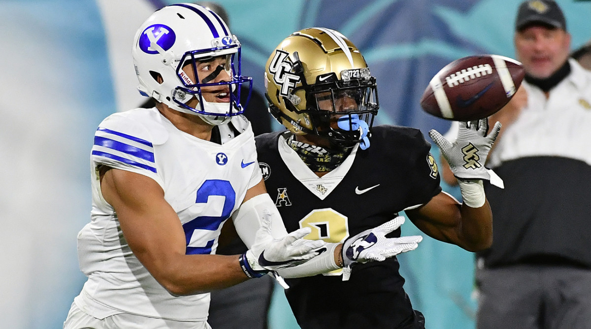 BYU and UCF football players on the field