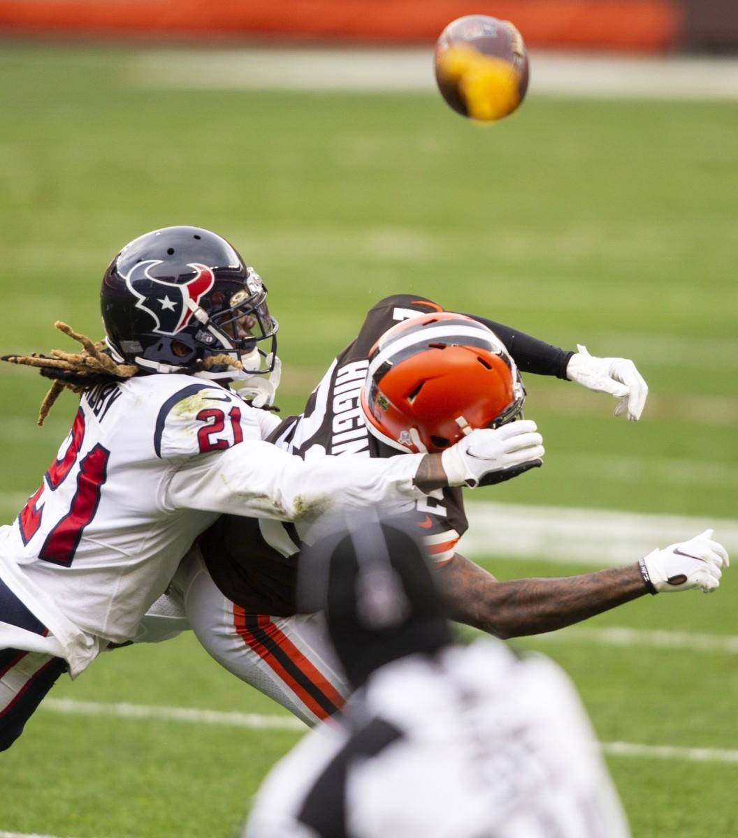 Houston Texans cornerback Bradley Roby (21) hits Cleveland Browns receiver Rashard Higgins (82). Mandatory Credit: Scott Galvin-USA TODAY Sports