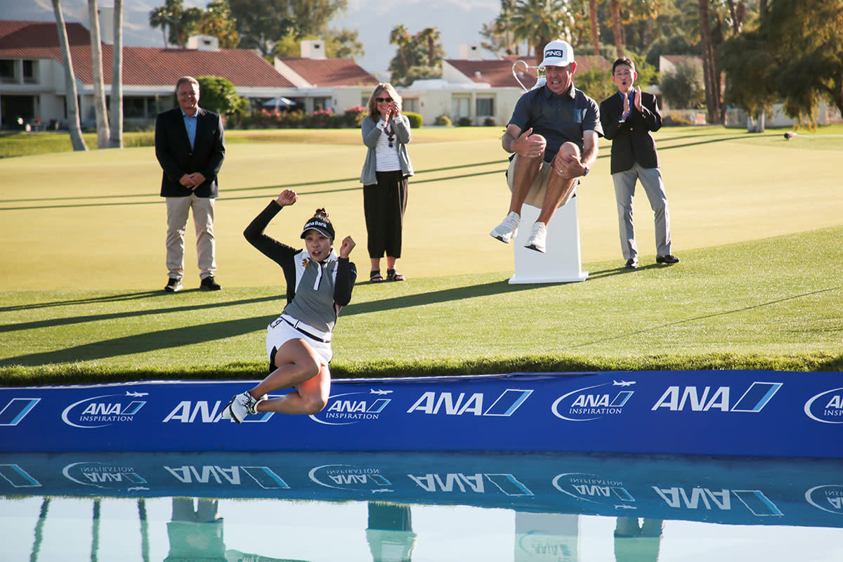 Patty Tavatanakit and her caddie leap into Poppy's Pond at the ANA Inspiration.