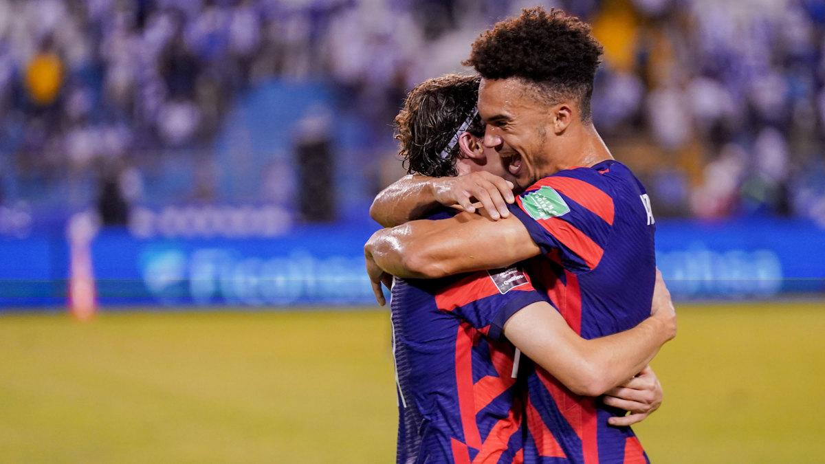 Antonee Robinson and Brenden Aaronson celebrate in the USA's win over Honduras